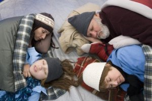 family-sleeping-in-tent